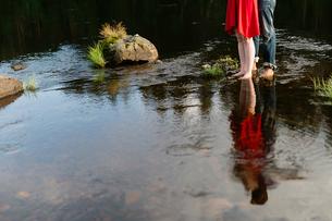 Sweden, Vastmanland, Bergslagen, Svartalven, Low section of mid adult couple standing in riverの写真素材 [FYI02199036]