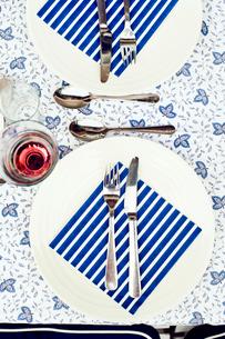 Sweden, Uppland, Danderyd, Fork and knife on striped napkinの写真素材 [FYI02199131]