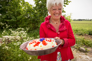 Sweden, Skane, Woman holding large dessert bowlの写真素材 [FYI02199491]