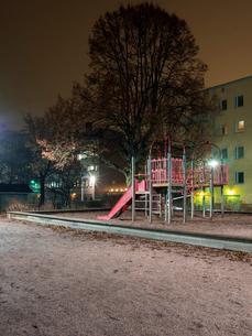 Finland, Usimaa, Helsinki, Lauttasaari, Playground at nightの写真素材 [FYI02199632]