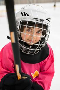 Sweden, Portrait of girl (6-7) in ice hockey uniformの写真素材 [FYI02199889]