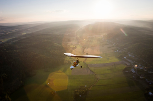 Sweden, Medelpad, Sundsvall, Pilot and passenger flying in microliteの写真素材 [FYI02199906]
