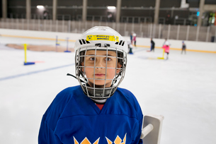 Sweden, Portrait of young male hockey player (8-9) on iceの写真素材 [FYI02199996]