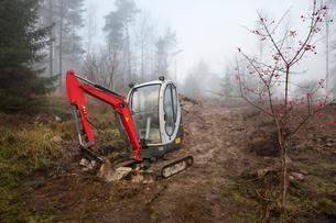 Sweden, Uppland, Nacka, Bulldozer in forestの写真素材 [FYI02200061]
