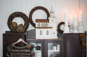 Sweden, Christmas decorations on cabinet in living roomの写真素材 [FYI02200643]
