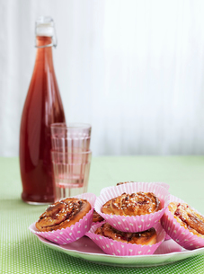 Sweden, Cinnamon buns and raspberry juice in bottleの写真素材 [FYI02200721]
