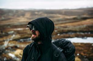 Sweden, Sylama, Jamtland, Portrait of backpacker in hooded jacketの写真素材 [FYI02200840]