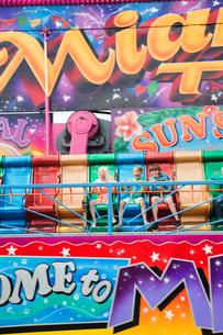 Sweden, Skane, Simrishamn, Excited children (10-11, 12-13) in amusement parkの写真素材 [FYI02200947]
