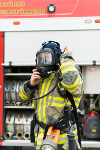 Sweden, Female firefighter putting on protective maskの写真素材 [FYI02200980]