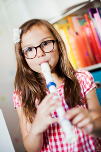 Sweden, Girl (6-7) playing fluteの写真素材 [FYI02201217]