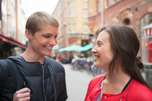 Sweden, Stockholm, Ostermalm, Two women standing face to faceの写真素材 [FYI02201284]