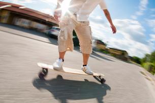 Sweden, Sodermanland, Sodertalje, Low section of man skateboardingの写真素材 [FYI02201731]
