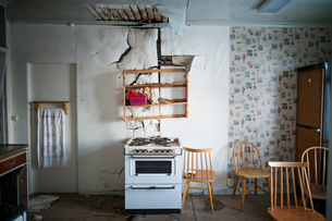 Sweden, Kitchen with damaged wallの写真素材 [FYI02201949]