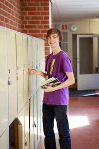 Sweden, Teenage boy (14-15) opening lockerの写真素材 [FYI02201961]