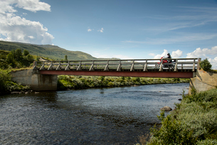 Norway, Hedmark fylke, Osterdalen, Man travelling on motorbikeの写真素材 [FYI02202173]