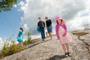 Sweden, Ostergotland, Braviken, Family with two children (6-7, 12-13) walking on asphaltの写真素材 [FYI02202272]