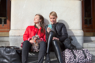 Sweden, Stockholm, Ostermalm, Two women listening to musicの写真素材 [FYI02202811]