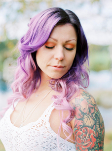 Sweden, Portrait of bride with long purple hair and tattoo at hippie weddingの写真素材 [FYI02202881]
