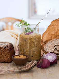 Sweden, Jar with mustard pickled herring, rye bread and crispbreadの写真素材 [FYI02203008]