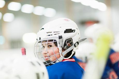 Sweden, Smiling boy (10-11) wearing hockey helmetの写真素材 [FYI02203029]
