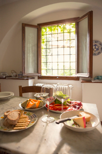 Italy, Tuscany, Dinner on table at farm houseの写真素材 [FYI02203072]