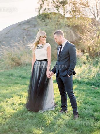 Sweden, Groom and bride standing together holding handsの写真素材 [FYI02203148]