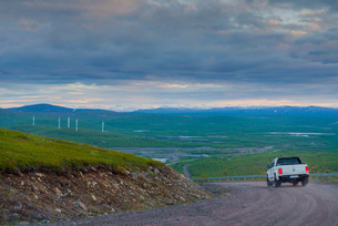 Sweden, Lapland, Kiruna, Luossavaara, Landscape view and car on dirty roadの写真素材 [FYI02203215]