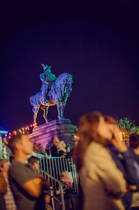 Sweden, Skane, Malmo, Illuminated equestrian statue of Charles X Gustav of Sweden with people in bluの写真素材 [FYI02203272]