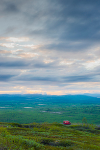 Sweden, Lapland, Kiruna, Luossavaara, Landscape view and car on dirty roadの写真素材 [FYI02203335]