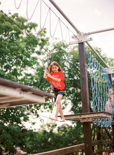 Sweden, Boy (8-9) walking on rope in adventure parkの写真素材 [FYI02203369]