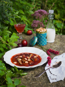 Sweden, Plum puree and almond biscuits on stoneの写真素材 [FYI02203426]