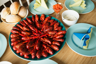 Sweden, Close-up of fresh crayfish on plateの写真素材 [FYI02203577]
