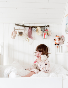 Sweden, Small girl (2-3) sitting in bed and embracing dollの写真素材 [FYI02203815]