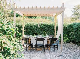 Sweden, Table under gazebo in gardenの写真素材 [FYI02203820]