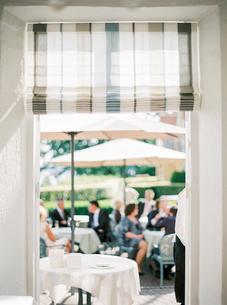 Sweden, People sitting under umbrellas at outdoors restaurantの写真素材 [FYI02203826]