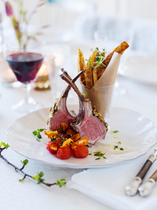 Sweden, Lamb chops and french fries on tableの写真素材 [FYI02203893]