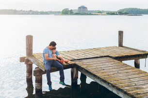 Sweden, Blekinge, Karlskrona, Father and son (8-9) by lakeの写真素材 [FYI02204013]
