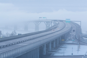 Sweden, Medelpad, Sundsvall, Elevated highway in fogの写真素材 [FYI02204015]