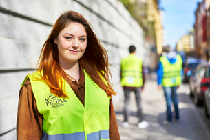 Sweden, Uppland, Stockholm, Kungsholmen, Volunteers on sidewalkの写真素材 [FYI02204250]