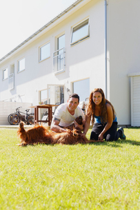 Sweden, Sodermanland, Ronninge, Portrait of couple with dog in back yardの写真素材 [FYI02204328]