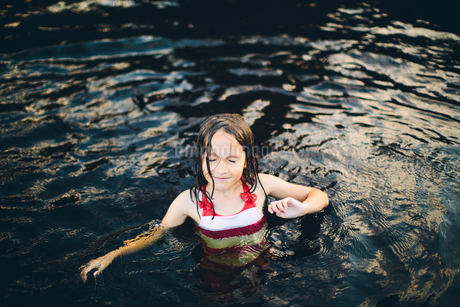 Sweden, Girl (8-9) in swimming costume standing in waterの写真素材 [FYI02204367]