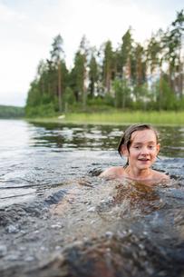 Sweden, Smaland, Braarpasjon, Boy (14-15) bathing in lakeの写真素材 [FYI02204394]