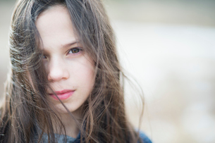 Sweden, Portrait of girl (10-11) with messy brown hairの写真素材 [FYI02204443]
