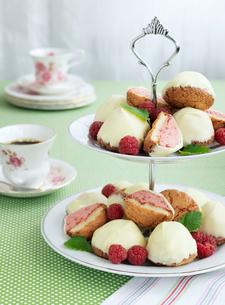 Sweden, Raspberry cakes on cake standの写真素材 [FYI02204503]