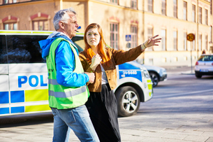 Sweden, Uppland, Stockholm, Kungsholmen, Volunteers on streetの写真素材 [FYI02204531]