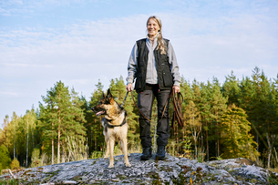 Sweden, Uppland, Rison, Portrait of volunteer with dog helping emergency services find missing peoplの写真素材 [FYI02204742]