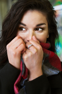 Sweden, Stockholm, Woman covering mouthの写真素材 [FYI02204747]