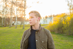 Sweden, Ostergotland, Mjolby, Young blonde man wearing jacketの写真素材 [FYI02204767]