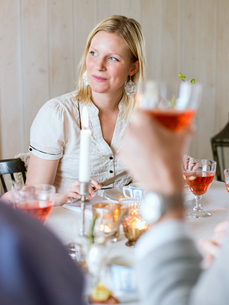 Sweden, Woman sitting at tableの写真素材 [FYI02204788]