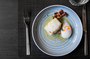 Sweden, Overhead view of plate with fish and poached eggの写真素材 [FYI02204796]